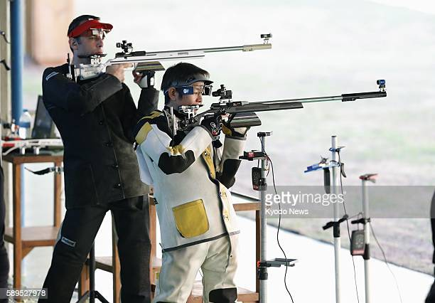 Japan's Toshikazu Yamashita shoots from a standing position during the men's 50meter rifle three positions qualification round at the Rio de Janeiro...