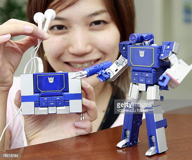 Japan's toy giant Tomy ermployee Chie Yamada displays a MP3 player 'Transformer Music Label Soundwave' based on characters of the recent Hollywood...