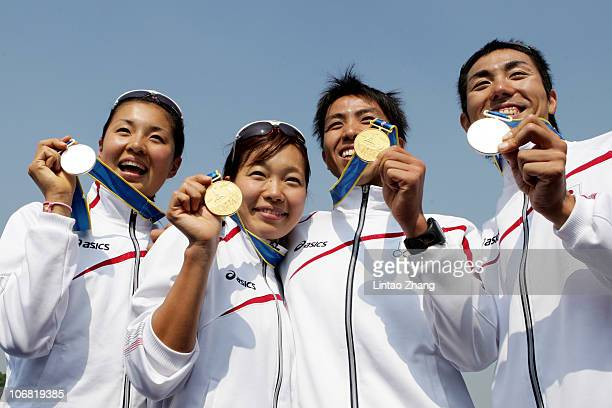Japan's Triathlon medallists Akane Tsuchihashi Mariko Adachi Yuichi Hosoda and Ryosuke Yamaoto pose with their medals at the Triathlon Venue during...