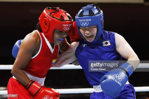 Japan's Tsukimi Namiki and Colombia's Ingrit Lorena Valencia Victoria fight in the second round of their women's flyweight boxing quarterfinal at the...