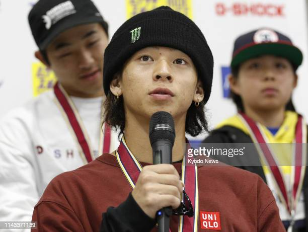 Japan's twotime Olympic snowboard silver medalist Ayumu Hirano speaks at a press conference after winning the men's park event at the national...