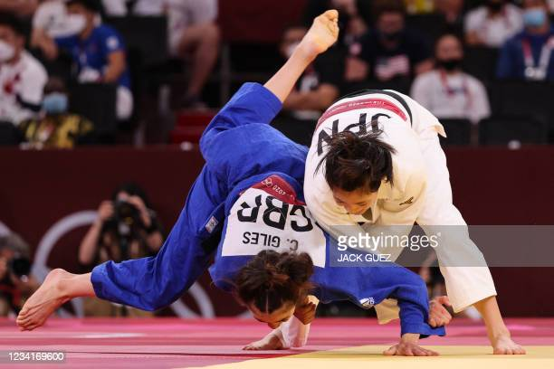 Japan's Uta Abe competes with Britain's Chelsie Giles during their judo women's -52kg quarterfinal bout during the Tokyo 2020 Olympic Games at the...