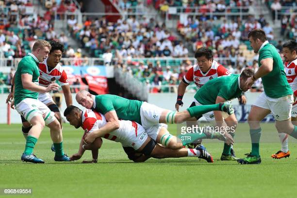 Japan's Uwe Helu is tackled by Ireland's Devin Toner as Japan's Yoshitaka Tokunaga Heiichiro Ito and Ireland's Dan Leavy watch during their rugby...