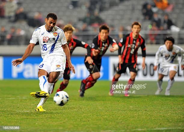 Japan's Vegalta Sendai forward Wilson Rodrigues Fonseca kicks a penalty against South Korea's FC Seoul during the AFC Champions League group E...