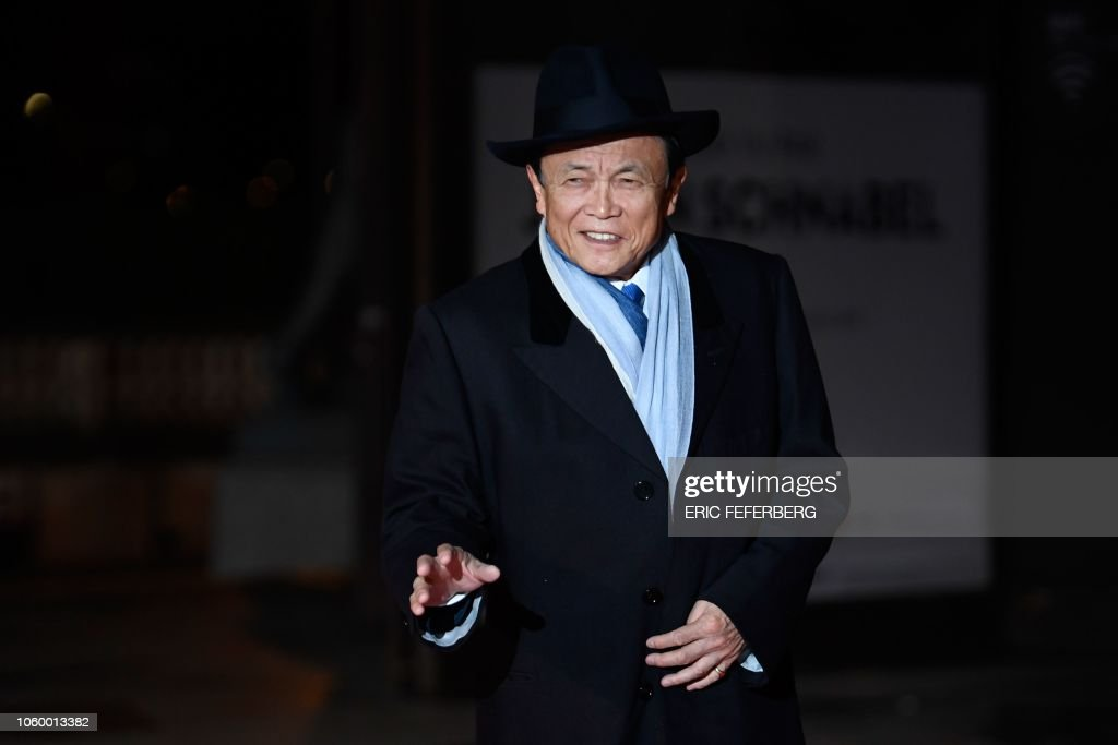 04c91d14 Japan's vice Prime Minister Taro Aso gestures as he arrives at the ...