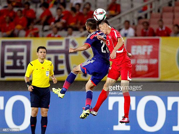 Japan's Wataru Endo and DPR Korea's Jang Kuk Chol vie for the ball during EAFF East Asian Cup 2015 final round on August 2 2015 in Wuhan China