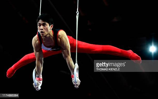 Japan's Wataru Tanigawa performs on the rings during the men's team final at the FIG Artistic Gymnastics World Championships at the...