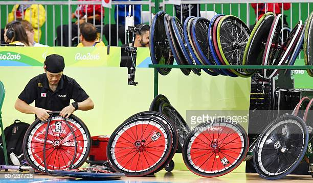 Japan's wheelchair rugby team staff repairs wheels on the courtside at the Rio de Janeiro Paralympics on Sept 16 2016