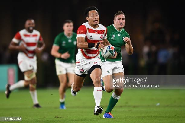 TOPSHOT Japan's wing Kenki Fukuoka breaks away and carries the ball during the Japan 2019 Rugby World Cup Pool A match between Japan and Ireland at...