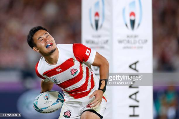 Japan's wing Kenki Fukuoka celebrates after scoring a try during the Japan 2019 Rugby World Cup Pool A match between Japan and Scotland at the...