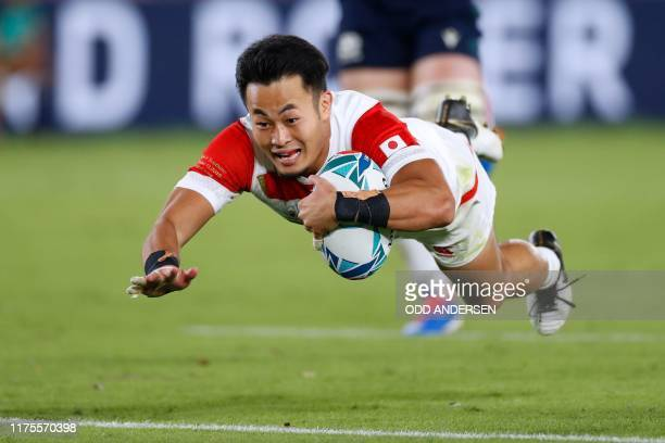 Japan's wing Kenki Fukuoka scores a try during the Japan 2019 Rugby World Cup Pool A match between Japan and Scotland at the International Stadium...