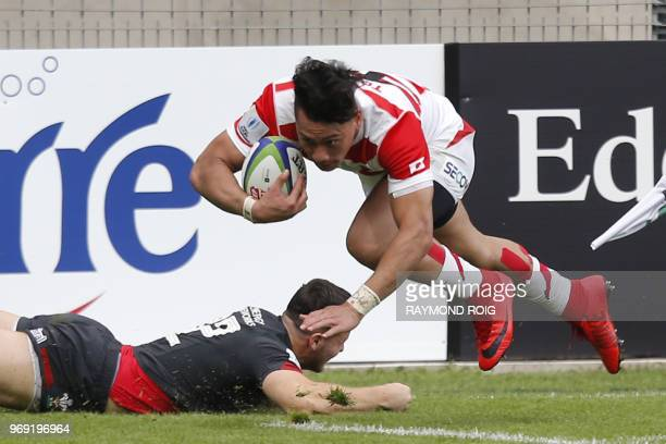 Japan's winger Halatoa Vailea runs with the ball during the U20 World Rugby union Championship match between Wales and Japan at the Aime Giral...