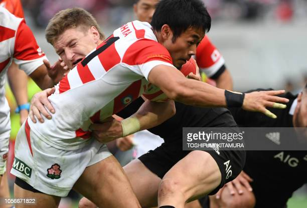 Japan's winger Kenki Fukuoka is tacked by New Zealand's All Blacks fullback Jordie Barrett during their rugby union International Test match in Tokyo...