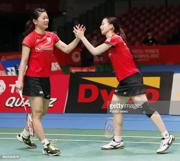Japan's world No 1 women's doubles pair of Ayaka Takahashi and Misaki Matsutomo celebrate after beating Indonesia's 50thranked duo Greysia Polii and...