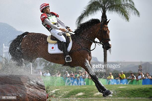 Japan's Yoshiaki Oiwa on The Duke of Cavan competes in the Eventing's Individual Cross Country of the Equestrian during the 2016 Rio Olympic Games at...