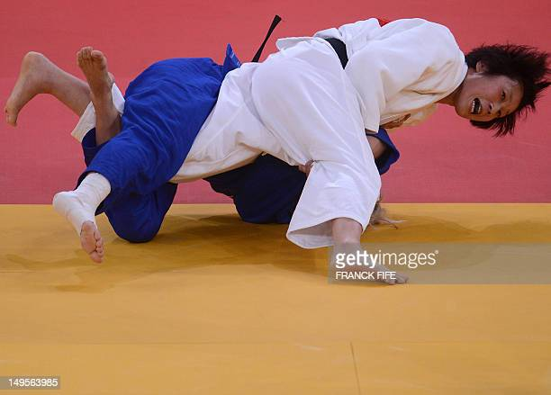 Japan's Yoshie Ueno competes with Croatia's Marijana Miskovic during their women's 63kg judo contest match of the London 2012 Olympic Games on July...