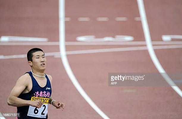 Japan's Yoshihide Kiryu crosses the finish line in the men's 100 metre race during the Seiko Golden Grand Prix in Tokyo on May 5, 2013. Kiryu...