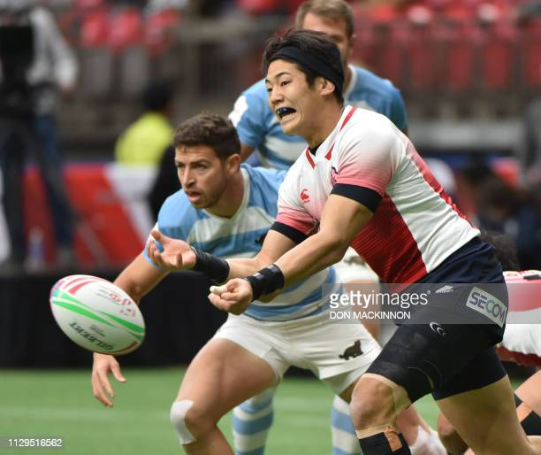 Japans Yoshikazu Fujita playing against Argentina passes the ball during World Rugby Sevens Series action in Vancouver BC on March 9 2019