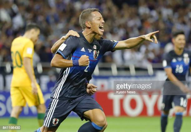 Japan's Yosuke Ideguchi celebrates after scoring the team's second goal against Australia in the second half of a World Cup finalround qualifier at...