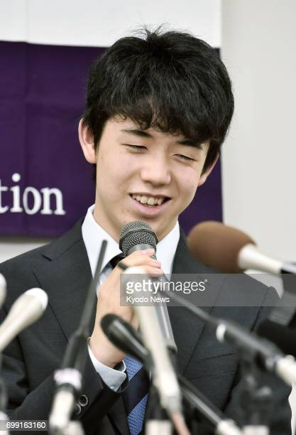 Japan's youngest professional shogi player 14yearold Sota Fujii attends a press conference in Osaka on June 21 after winning his 28th straight match...