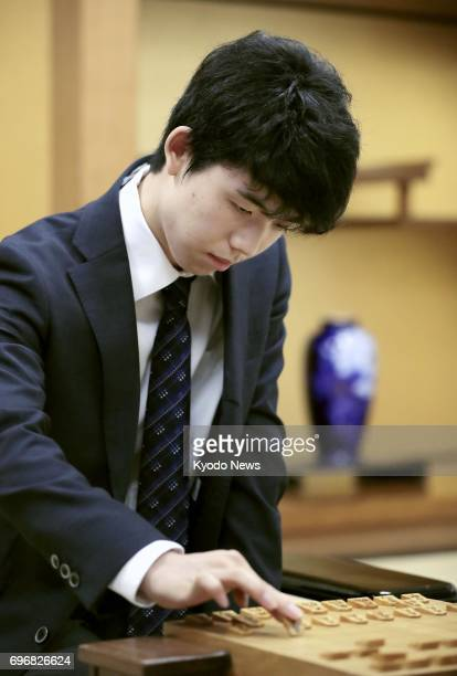 Japan's youngest professional shogi player 14yearold Sota Fujii makes a move during a preliminary round match against amateur player Hayata Fujioka...