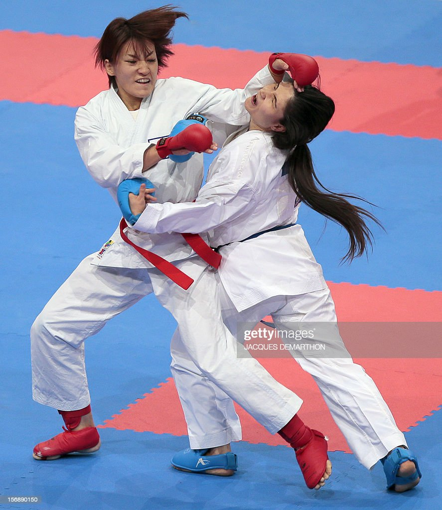 Japan's Yu Miyamoto (L) fights against Turkey's Ece Yasar (R) in the women's under 61 kg category during the 2012 World Karate Championships on November 24, 2012 in Paris.