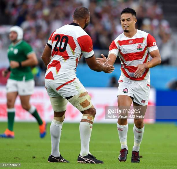 Japan's Yu Tamura congratulated by Michael Leitch after his third penalty during the Rugby World Cup 2019 Group A game between Japan and Ireland at...