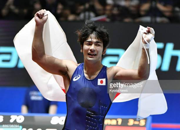 Japan's Yuhi Fujinami celebrates after winning a bronze medal in the men's 70kilogram freestyle competition at the world wrestling championships in...