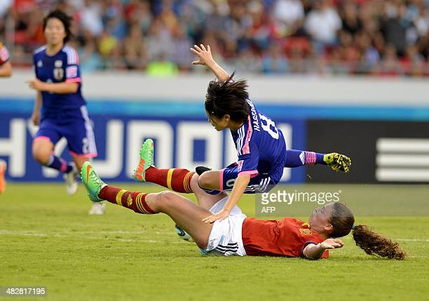 Japan's Yui Hasegawa and Spain's Nuria Garrote vie for the ball during their FIFA U17 Women's World Cup Costa Rica 2014 final match at the National...