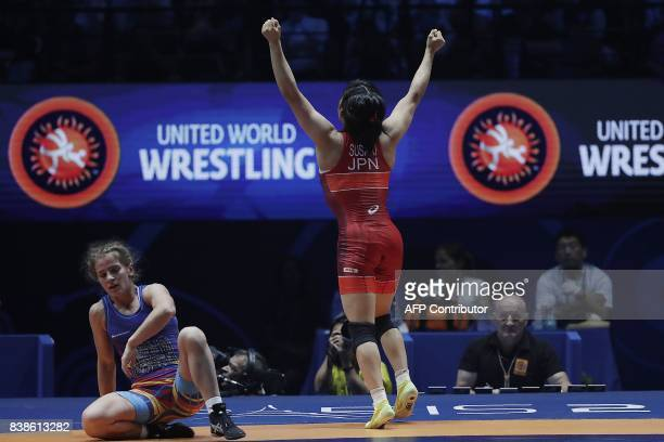 Japan's Yui Susaki celebrates after beating Romania's Emilia Alina Vic during the women's freestyle wrestling 48kg category final of the FILA World...
