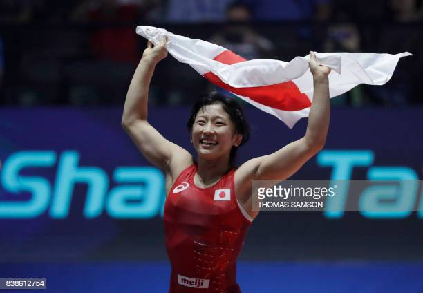 Japan's Yui Susaki celebrates after she won against Romania's Emilia Alina Vic during the women's freestyle wrestling 48kg category final of the FILA...