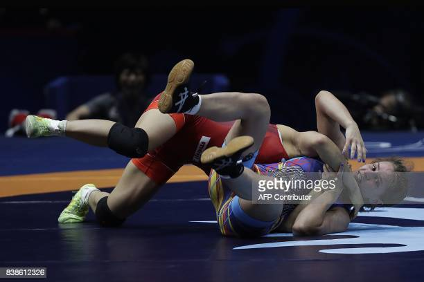 Japan's Yui Susaki competes with Romania's Emilia Alina Vic during the women's freestyle wrestling 48kg category final of the FILA World Wrestling...