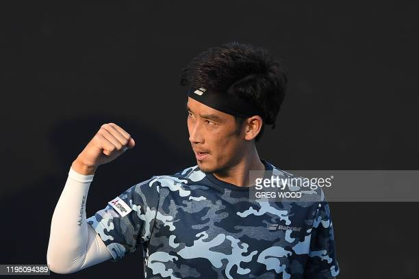 Japan's Yuichi Sugita celebrates after victory against France's Elliot Benchetrit during their men's singles match on day two of the Australian Open...