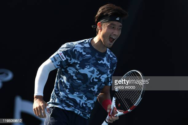 Japan's Yuichi Sugita reacts after a point against France's Elliot Benchetrit during their men's singles match on day two of the Australian Open...