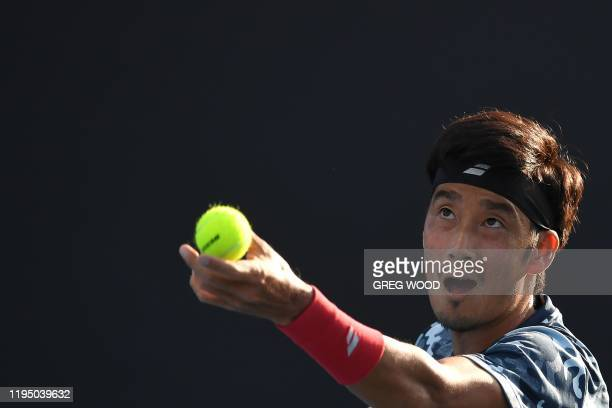 Japan's Yuichi Sugita serves against France's Elliot Benchetrit during their men's singles match on day two of the Australian Open tennis tournament...