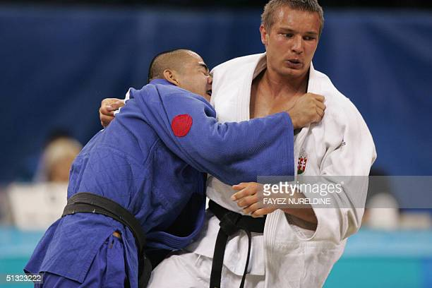 Japan's Yuji Kato competes with Hungary's Gabor Vincze in the 81kg category of the men's Judo competition at the Ano Liossia Olympic Hall in Athens...