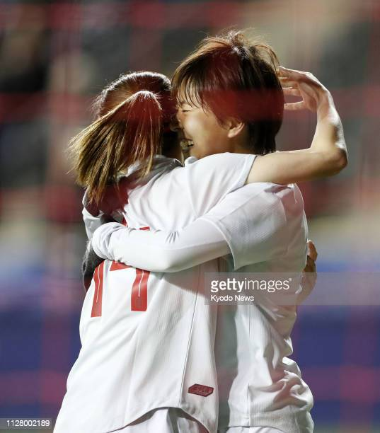 Japan's Yuka Momiki hugs Yui Hasegawa after scoring an equalizer in the second half of a SheBelieves Cup women's football match against the United...
