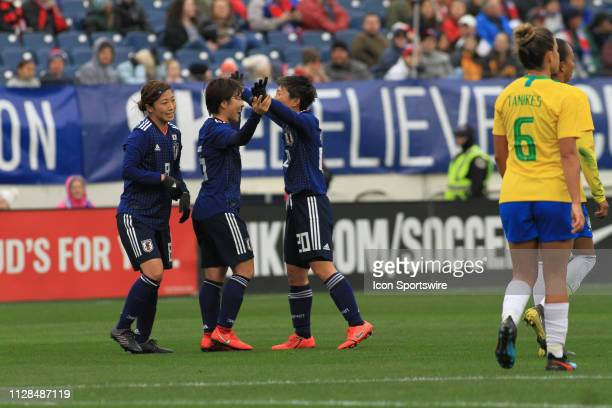 Japan's Yuka Momiki is congratulated by Kimi Yokoyama after scoring the first goal of the match during a SheBelieves Cup match between Brazil and...