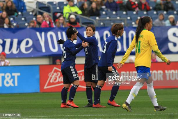 Japan's Yuka Momiki is congratulated by Moeno Sakaguchi after scoring the first goal of the match during a SheBelieves Cup match between Brazil and...