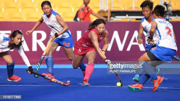 Japan's Yukari Mano controls the ball during the women's hockey pool A match between Japan and Taiwan at the 2018 Asian Games in Jakarta on August 19...