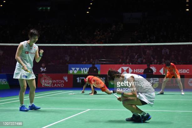 Japan's Yuki Fukushima and Sayaka Hirota celebrate their win over China's Du Yue and Li Yin Hui in their All England Open Badminton Championships...