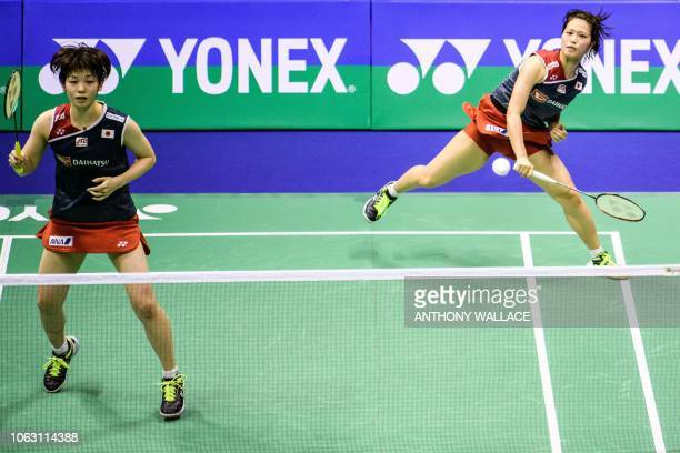 Japan's Yuki Fukushima and Sayaka Hirota hit a return during their women's doubles final against South Korea's Lee Sohee and Shin Seungchan at the...