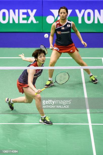 Japan's Yuki Fukushima and Sayaka Hirota play a return during their women's doubles final against South Korea's Lee Sohee and Shin Seungchan at the...