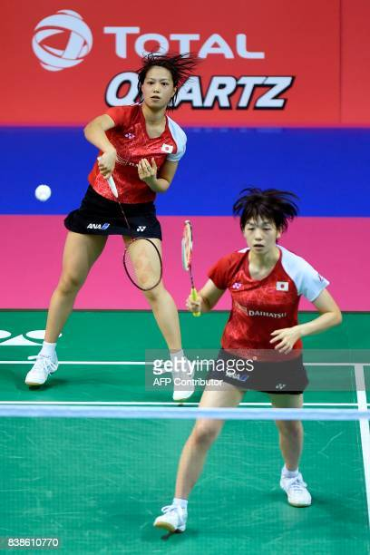 Japan's Yuki Fukushima and Sayaka Hirota return to China's Dongping Huang and Yinhui Li during their round three women's doubles match during the...