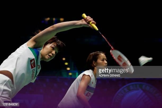 Japan's Yuki Fukushima stands by as Japan's Sayaka Hirota plays a return against Japan's Mayu Matsumoto and Japan's Wakana Nagahara during the...