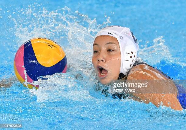 Japan's Yuki Niizawa swims with the ball against Indonesia in the womens water polo Preliminary Group A event during the 2018 Asian Games in Jakarta...