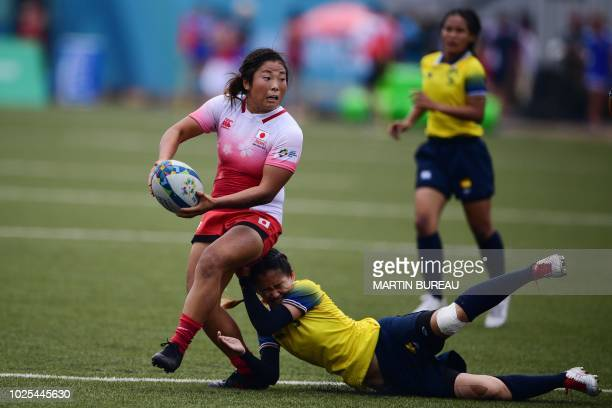 Japan's Yume Okuroda is tackled by Thailand's Rasamee Sisongkham during the women preliminary round group B rugby sevens match between Japan and...