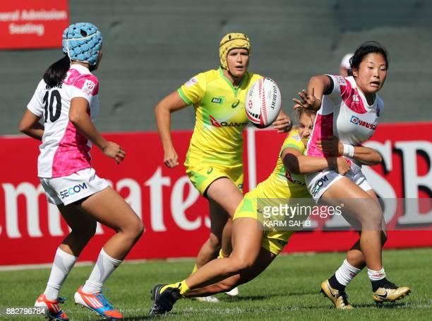 Japan's Yume Okuroda passes to teammate Yume Hirano during the Women's Sevens World Dubai Series rugby union match in the Gulf emirate of Dubai on...