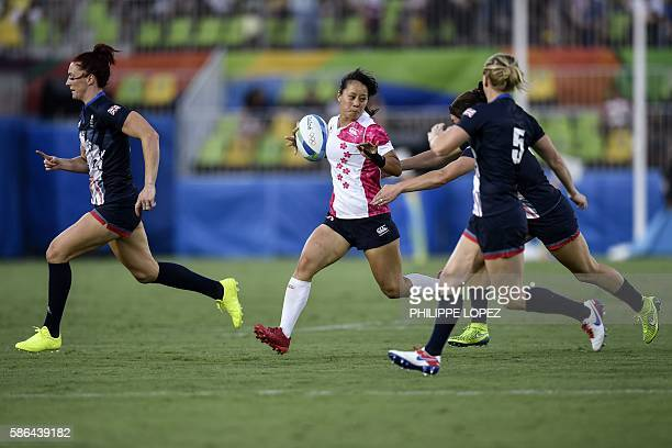 Japan's Yume Okuroda runs with the ball in the womens rugby sevens match between Britain and Japan during the Rio 2016 Olympic Games at Deodoro...