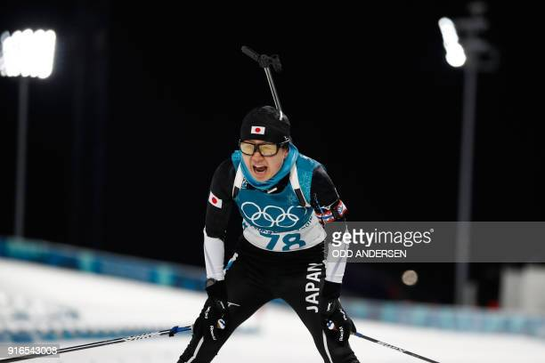 Japan's Yurie Tanaka reacts after crossing the finish line of the women's 75 km sprint biathlon event during the Pyeongchang 2018 Winter Olympic...
